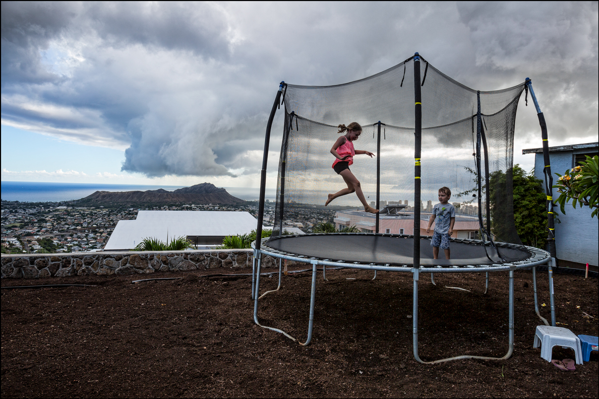 Makena Young and brother Sam play on trampoline in Honolulu on September 18, 2014