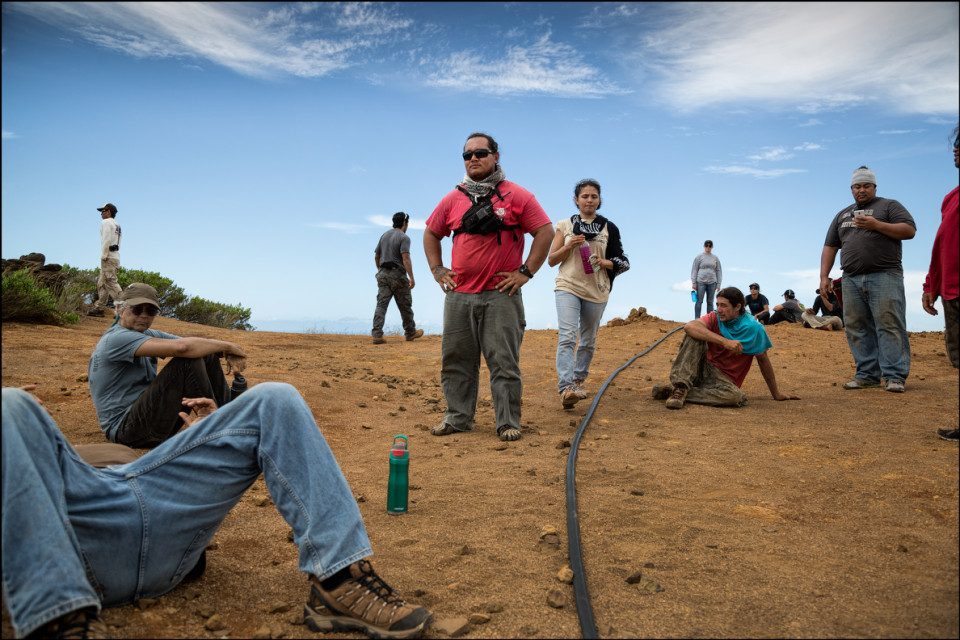 KIRC Cultural Resources Project Coordinator Guide Kuiokalani Gapero and his charges at the highest point on Kahoʻolawe, the summit of Puʻu Moaulanui, which is about 1,477 feet above sea level. 9.29.14
