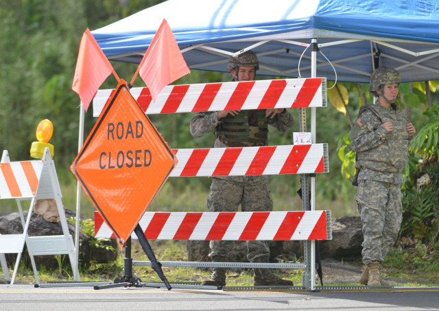 Members from the Task Force Response Army and Air National Guard personnel stand at road block at Pahoa Village Road and Post Office Road only allowing residents that live in the area passage. No media are allowed within this road blocked areas. 30 October 2014. photo Cory Lum