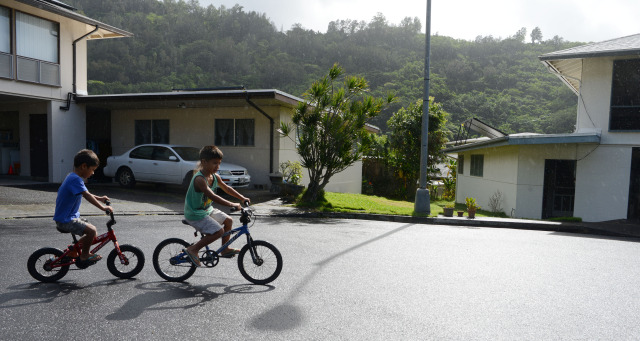 Left, 5-year-old Katin Tilton and right, brother 6-year-old Dayten Tilton enjoy a morning bike ride in their cul de sac off of Booth Road in Pauoa Valley. 29 nov 2014. photograph by Cory Lum