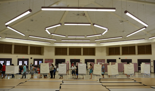 Voters at Kapolei High School as they cast their vote. Kapolei, Hawaii. 4 November 2014. photograph by Cory Lum
