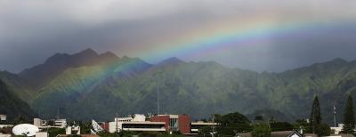 Light afternoon rains create a iridescent rainbow over Manoa Valley. 25 nov 2014. photograph Cory Lum.