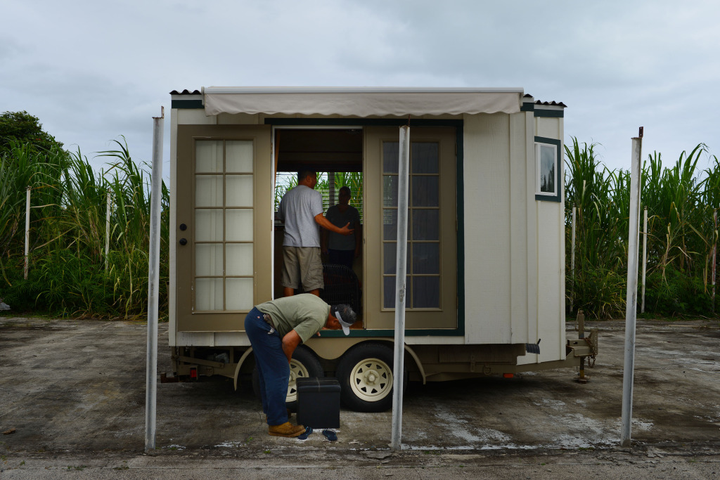 Brandon Nishiki shows his home that he built on a trailer featuring water and a toilet. contact information 808.271.6485 or email bnishiki.halekanoa@gmail.com