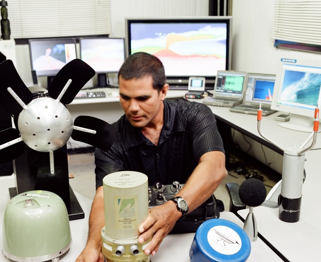Dr. Milton Garces, Ph.D, founder of Red Vox, tinkers with the infrasound equipment that he and his team hope to commercialize with help from XLR8UH.
