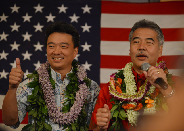 Gubernatorial candidate David Ige speaks to crowd after second printout as running mate Shan Tsutsui gives the thumbs up at the Democratic Party of Hawaii's Democratic Coordinated Election Night Celebration held at the Japanese Cultural Center of Hawaii.  4 November 2014. photograph by Cory Lum