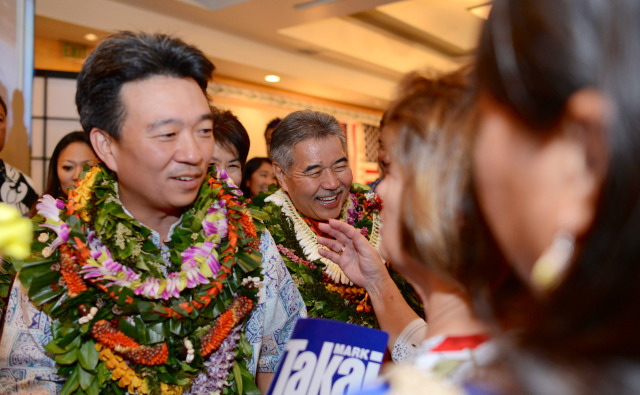 Gubernatorial candidate David Ige and running mate Shan Tsutsui after third print out at Democratic Party of Hawaii's Democratic Coordinated Election Night Celebration held at the Japanese Cultural Center of Hawaii. 4 November 2014. photograph by Cory Lum