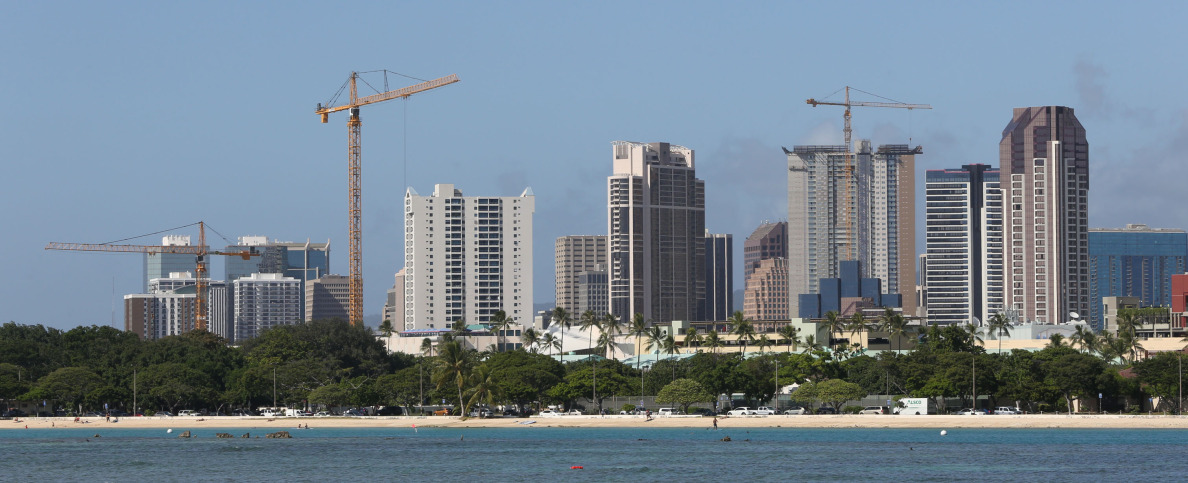 View of construction cranes in Kakaako with future developments planned.  20 nov 2014. photo Cory Lum.