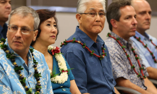 Left, Jim Robo Chairman and CEO, NEXTERA Energy, Inc. sits next to Connie Lau, President and CEO Hawaiian Electric Industries before speaking at press conference announcing a merger with NEXTERA at suite 800, 1001 Bishop Street. Honolulu, Hawaii. 3 dec 2014. photograph by Cory Lum