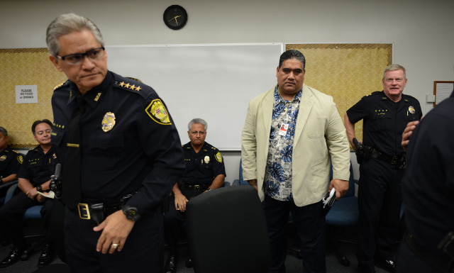 Chief Louis Kealoha stands with SHOPO President Tenari Ma'afala as the commission heads into executive session at the Honolulu Police Departments main station, conference room A. 17 dec 2014. photo Cory Lum