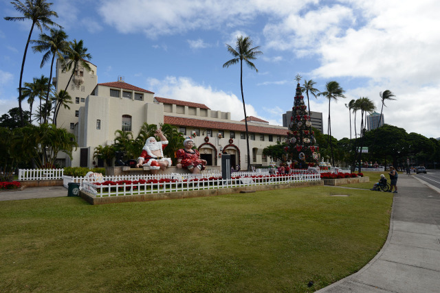 Honolulu Hale bedecked w/ seated Mr. and Mrs. Claus and other holiday decorations.  11 dec 2014. photograph Cory Lum