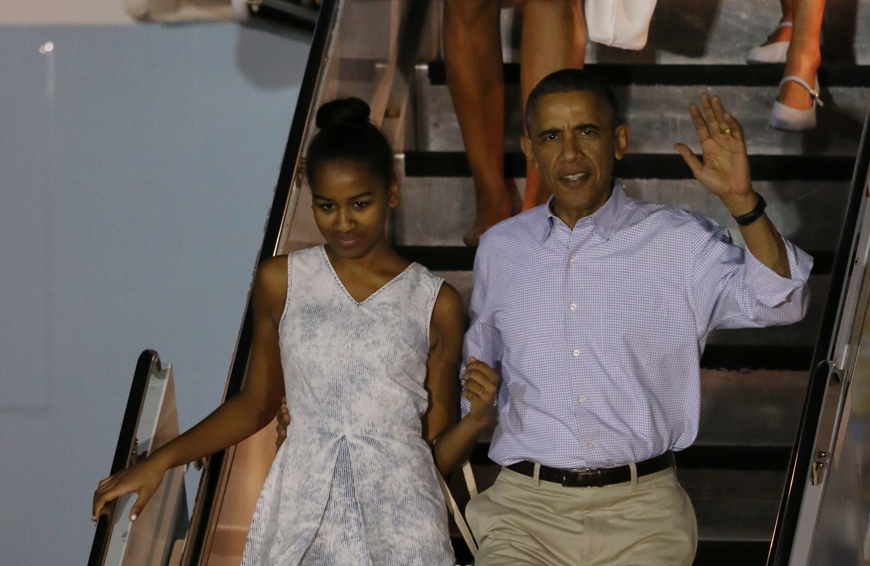 President Obama and Sasha look out at the greeting party.
