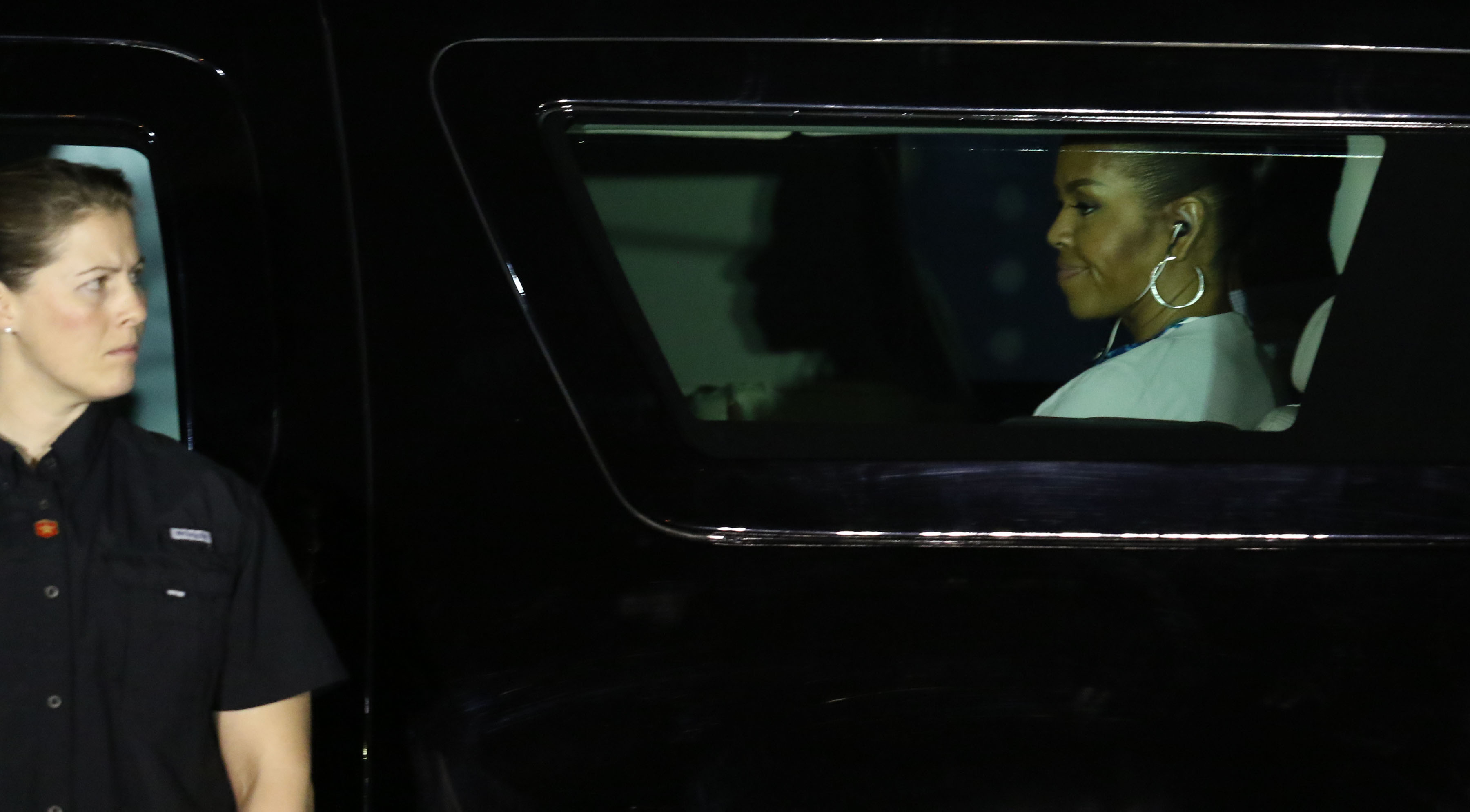First Lady Michelle Obama sits in an SUV with President Obama after disembarking from Air Force One. It was about 4 a.m. her time.