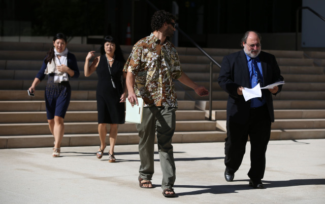 Federal Public Defender Alexander Silvert walks out of Federal Building before press conference about his client Gerard Puana. 16 dec 2014. photograph Cory Lum