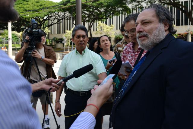 Federal Public Defender Alexander Silvert tells media case against his client Gerard Puana has been dismissed. 16 dec 2014. photograph Cory Lum