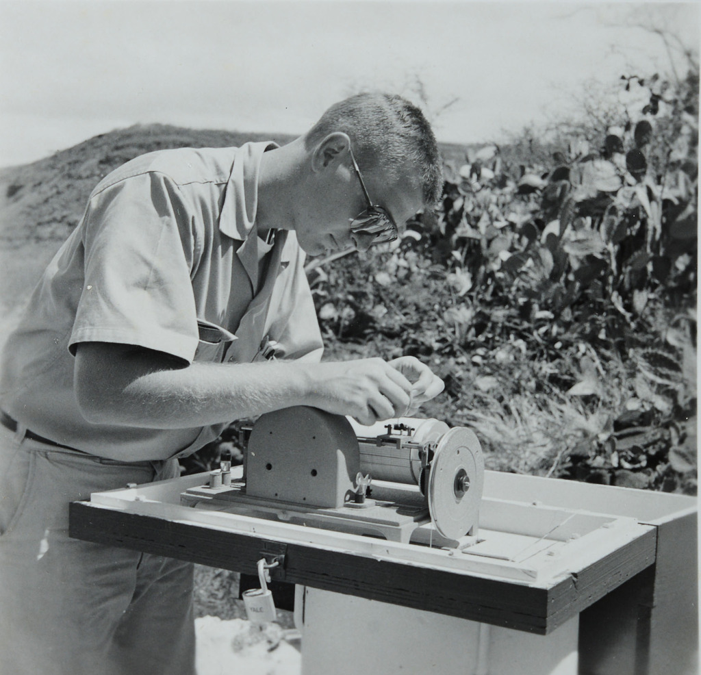 Bill Balfour makes some adjustments to a weather station in the 1960s. copy photograph. courtesy Bill Balfour