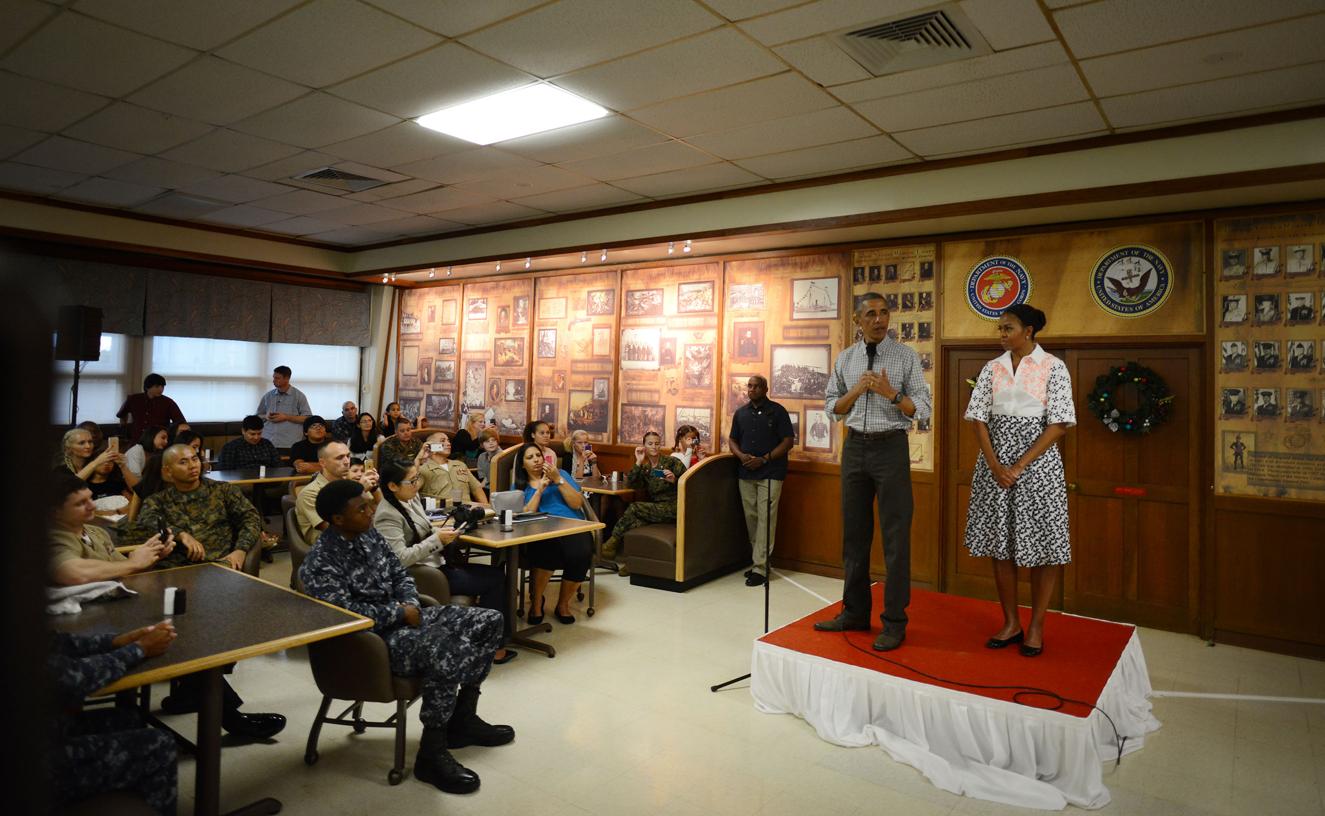 <p>One of the few official duties for the president during his Hawaiian vacations has been to pay Christmas Day visits to service members and their families at Marine Corps Base Hawaii. The president is joined by the first lady as he addresses the troops in 2014.</p>