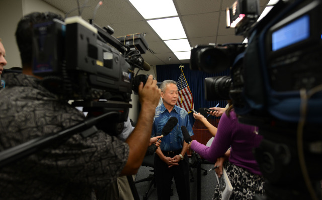 Honolulu Police Commissioner Chair Ronald Taketa speaks to media after executive sessions held at HPD headquarters conference room A. 17dec2014. photograph Cory Lum