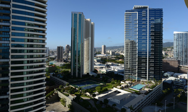 View of Nauru tower left and other developments and condominiums in Kakaako.  6jan2015. photograph Cory Lum