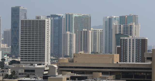 High rise condominiums rise up in Honolulu, Hawaii. 15 jan 2015. photograph Cory Lum/Civil Beat