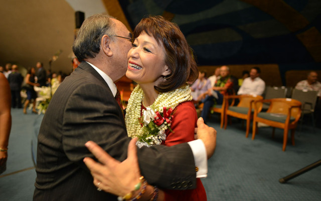 Senate President Donna Kim receives a kiss before senate opens before opening ceremonies at the Capitol building.  21 jan 2015. photograph Cory Lum/Civil Beat