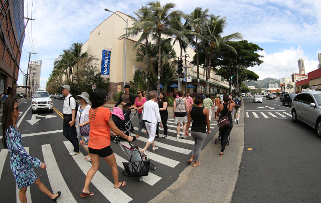 Pedestrians crowd the streets of Honolulu.