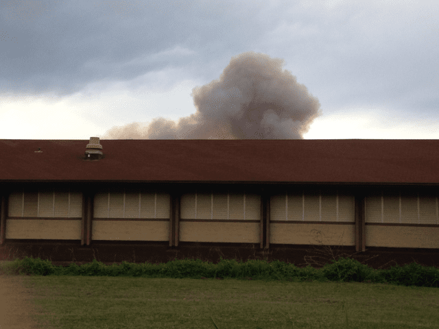 Smoke looms over King Kekaulike High School in Pukalani, Maui.