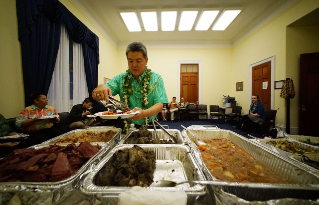 Congressman Mark Takai loads up his plate on 'aloha friday' at this offices. 27 feb 2015. photograph Cory Lum/Civil Beat