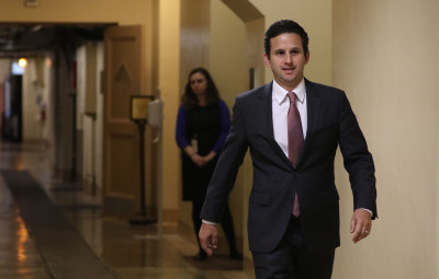 Senator Brian Schatz heads down the corridor basement on his way to the Capitol Subway system. 23 feb 2015. photograph Cory Lum/Civil Beat