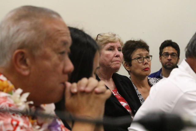 Speaker Calvin Say sits as Representatives question to his attorney as challenger right, Keiko Bonk looks on.  13 feb 2015. photograph Cory Lum/Civil Beat