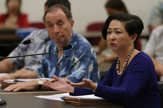 Right, State Auditor Jan Yamane and Jeff Kissell Executive Director of the Hawaii Health Connector answer questions after the auditor presented her report. 9 nov 2015. photograph Cory Lum/Civil Beat