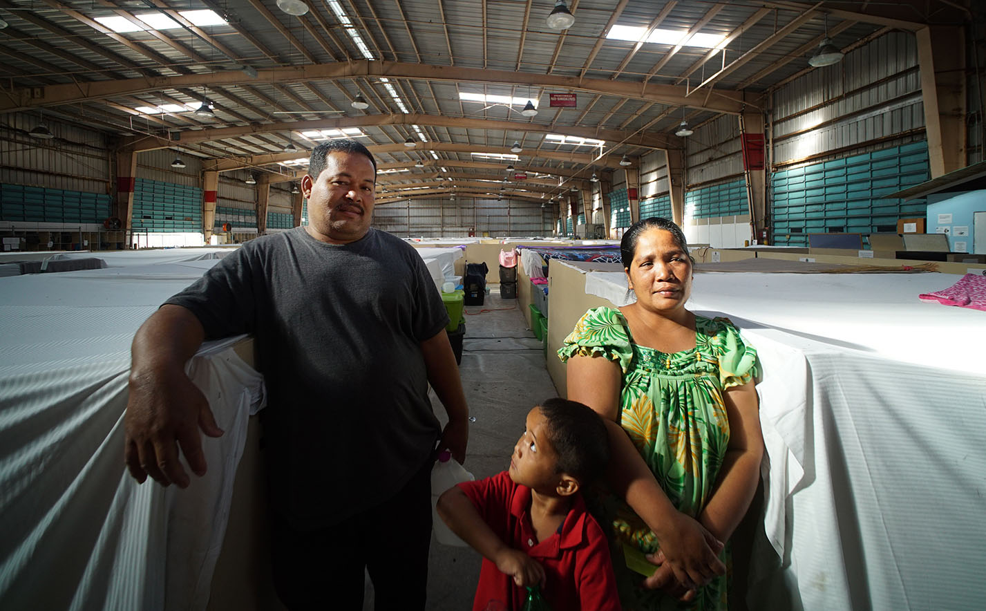 <p>Careless Mathin, left, and Kiana Kasper found shelter for their family at the Next Step homeless shelter in Honolulu. Originally from Chuuk, they came to Hawaii so that Mathin could treat his diabetes. Photo by Cory Lum.</p>