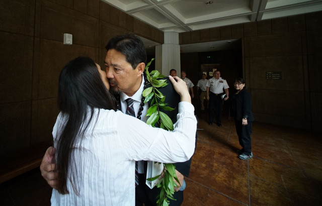 Chair DLNR candidate Carleton Ching receives a lei before senate confirmation hearing at the Capitol. 11 march 2015. photograph Cory Lum