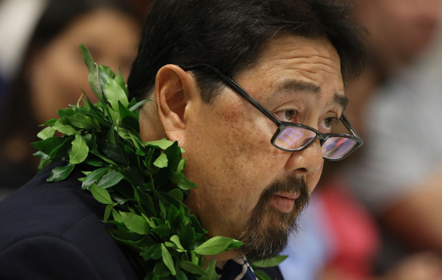 DLNR nominee Carleton Ching enters second day of senate hearing.  12 march 2015. photograph Cory Lum/Civil Beat