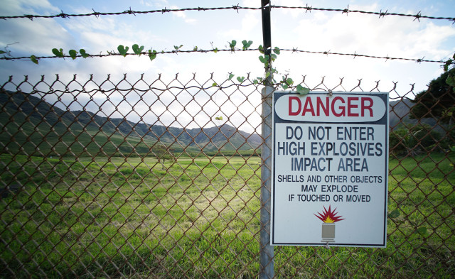 Sign and barbed wired fence fronting Makua Valley. 14 march 2015. photograph Cory Lum/Civil Beat