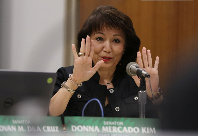 Senate President Donna Mercado Kim gestures during Ways and Means meeting while questioning Mayor Kirk Caldwell.  4 march 2015. photograph Cory Lum/Civil Beat