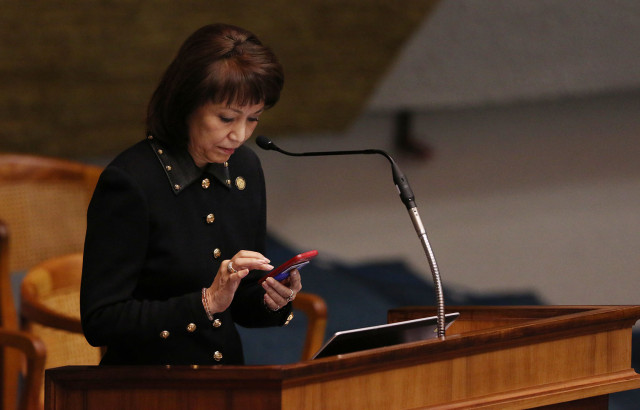 Senate President Donna Mercado Kim texts while Senator Inouye addresses Senate after DLNR nominee Carleton Ching's nomination was withdrawn.  18 march 2015. photograph Cory Lum/Civil Beat