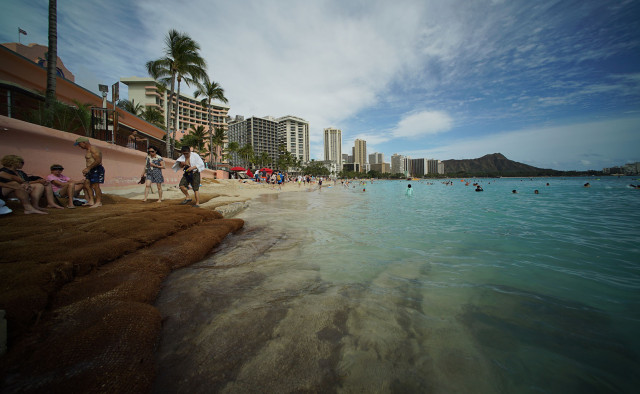 Walkway overlooking a beach wall near the makai side of the Royal Hawaiian Hotel. 5 March 2015. photograph Cory Lum/Civil Beat
