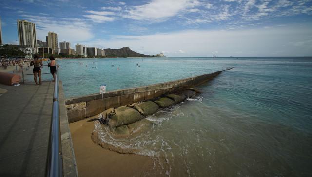 Walkway overlooking a beach wall near the makai side of the Sheraton Waikiki Hotel. 5 March 2015. photograph Cory Lum/Civil Beat
