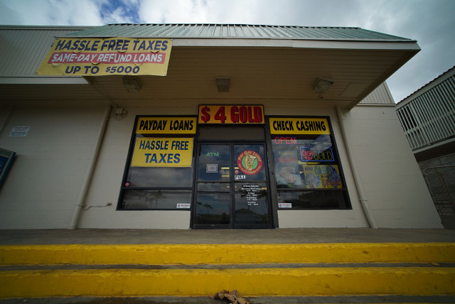 Payday lending shop next to 7-11 in Waianae. 21 march 2015. photograph Cory Lum/Civil Beat