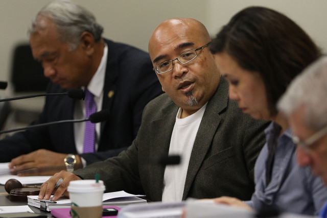 Chair Gil Keith Agaran in a meeting about  Senator Brickwood Galuteria's residency. 27 april 2015. photograph by Cory Lum/Civil Beat