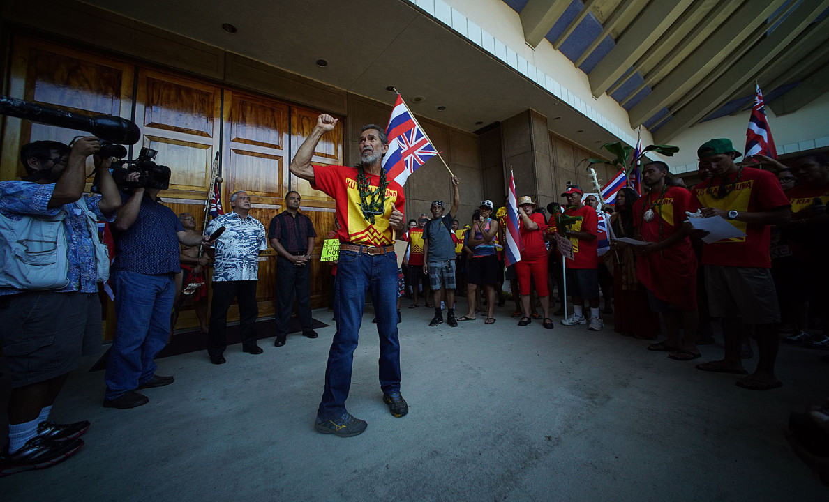 Walter Ritte speaks to demontrators outside Governor Ige's office at the Capitol. 21 april 2015. photograph Cory Lum/Civil Beat