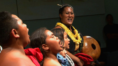 Kumu Hina, right, instructs members of her halau or hula school. Kumu Hina is both a teacher and a mahu, or transgender woman.