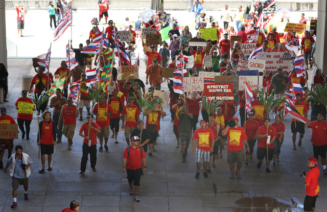 Mauna Kea demonstrators enter the Hawaii Capitol Rotunda after walking from the OHA office. 21 april 2015. photograph Cory Lum/Civil Beat