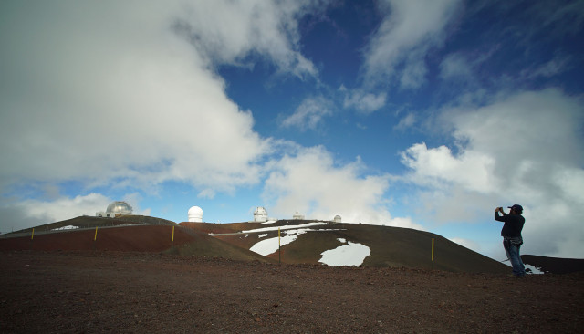 Visitor makes a photograph of the various telescopes on the summit of Mauna Kea. 9 april 2015. photograph Cory Lum/Civil Beat