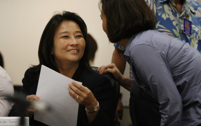 Rep Sylvia Luke and Sen Jill Tokuda chat after joint WAM/Finance committee meeting on the excise tax extension. 27 april 2015. photograph Cory Lum/Civil Beat