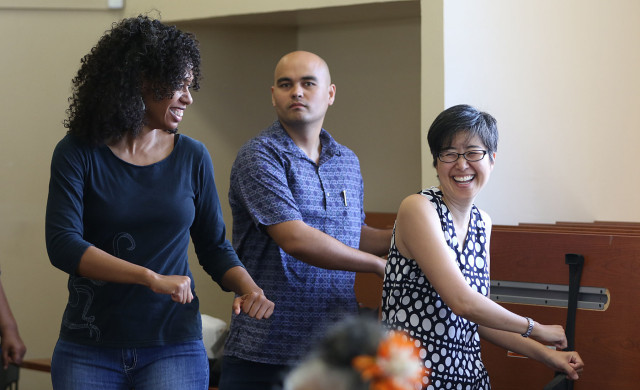 Medical-Legal Partnership for Children in Hawaii.  Left-Right, U'ilani Goods, and attorneys Randy Compton, Dina Shek dance during senior dance class at the Kuhio Park Terrace Family Center. These lawyers assist some of the residents thru their their tiny office located inside the Kokua Kalihi Valley Comprehensive Family Services community health center.  12 may 2015. photograph Cory Lum/Civil Beat