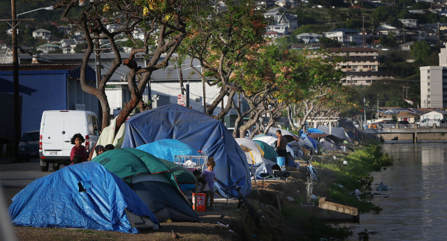 Tents and other belongings along the shores of the Kapalama Canal. 19 may 2015. photograph by Cory Lum/Civil Beat