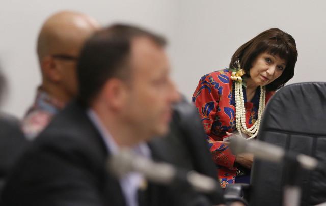 Senate President Donna Mercado Kim listens to Sen Josh Green as he negotiates wording on the marijuana dispensary bill.  1 may 2015. photograph by Cory Lum/Civil Beat