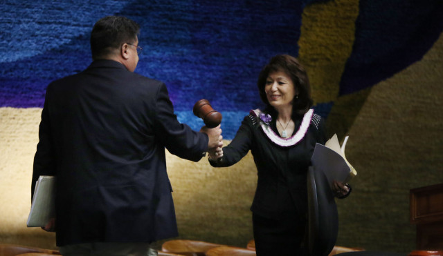 Outgoing Sen President Donna Mercado Kim passes the gavel to the newly elected Senate President Donald Kouchi.  5 may 2015. photograph Cory Lum/Civil Beat