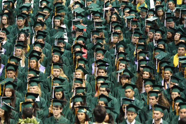 University of Hawaii students sit during undergraduate degree ceremony held at Stan Sheriff Center. 16 may 2015. photograph by Cory Lum/Civil Beat